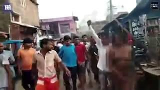 Woman paraded naked by mob over rumours she had killed a man