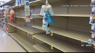 Store shelves emptied as shoppers stock up on supplies ahead of Hurricane Lane