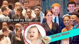 Can you see, my love? Meghan accidentally collapses into a giggle after Harry reveals is pregnant