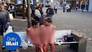 Naked women covered in jam cause a spectacle in city centre