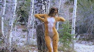 Naked Woman in forest gets Body Painting as a cat, puts on ears and tail