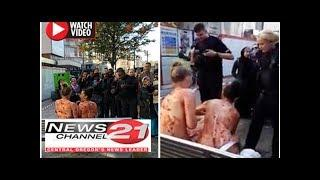 Two naked women smearJAM on each otheras baffled Manchester residents watch on
