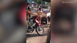 Woman Dances Through River In Underwear