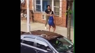Woman gets butt naked in the middle of a fight (Viral Video)