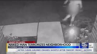 WARNING: Disturbing details, naked man caught on camera creeping near house