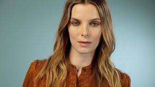 Betty Gilpin says her first body slam of Alison Brie felt like 'an injection of glitter heroin'