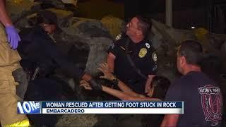 Half-naked woman rescued after getting foot stuck in rock